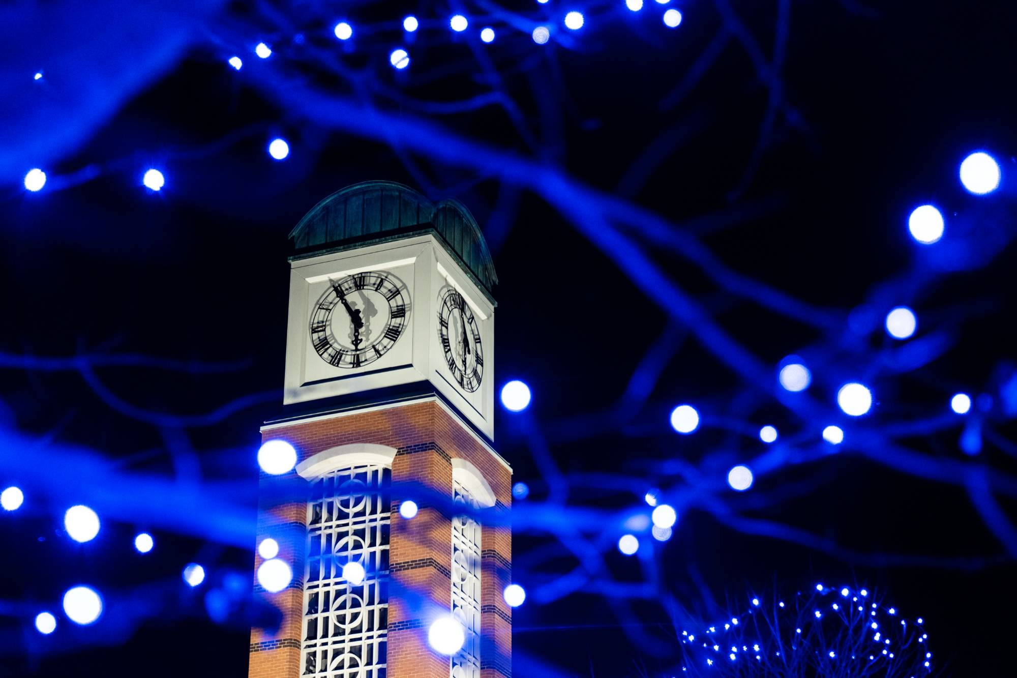 The Cook Carillon Tower surrounded by blue holiday lights